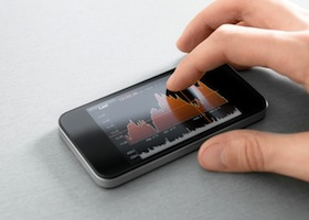 Hand touching stock market chart on mobile smart phone.