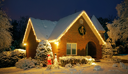 house in the winter time with christmas lights and decorations displaying signs of good home security-10-25