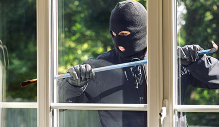 Burglar trying to break into house with a home security monitoring system-MP-2-25